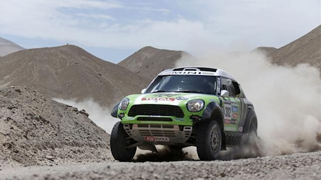 France's Stephane Peterhansel and co-pilot Jean-Paul Cottret compete with their Mini during the 5th stage of the Dakar Rally 2013 from Arequipa in Peru to Arica in Chile (Reuters)
