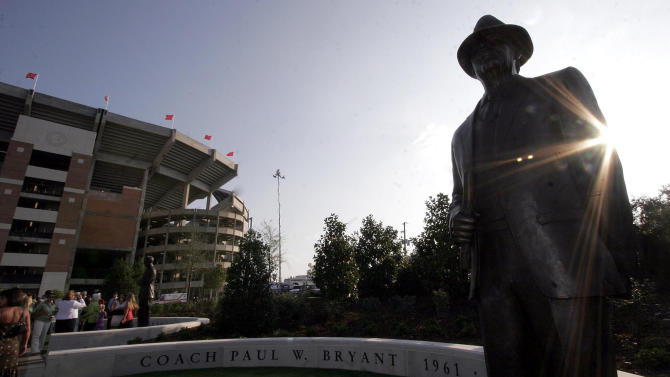 """FILE - In this Aug. 31, 2006, file photo, the late-afternoon sun shines off a statue of Paul """"Bear"""" Bryant during the grand opening of the newly-remodeled Bryant-Denny Stadium at the University of Alabama in Tuscaloosa, Ala. (AP Photo/Tuscaloosa News, Michelle Williams, File)"""