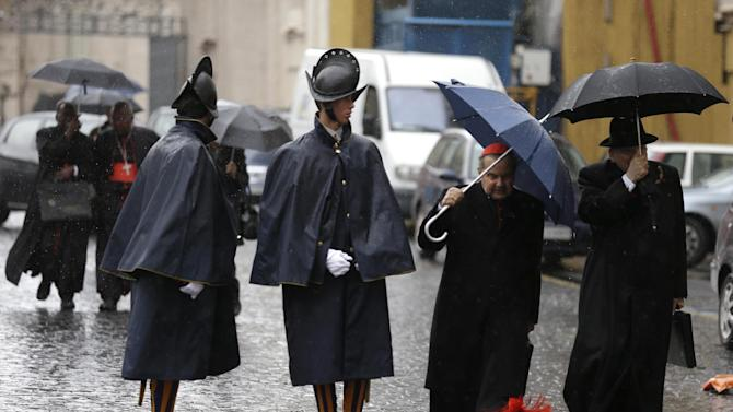 "Cardinal Carlo Caffarra, second from right, and Cardinal Raymond Leo Burke, right, walk past two Swiss guards as they leave after a meeting at the Vatican, Friday, March 8, 2013 The Vatican says the conclave to elect a new pope will likely start in the first few days of next week. The Rev. Federico Lombardi told reporters that cardinals will vote Friday afternoon on the start date of the conclave but said it was ""likely"" they would choose Monday, Tuesday or Wednesday. The cardinals have been attending pre-conclave meetings to discuss the problems of the church and decide who among them is best suited to fix them as pope. (AP Photo/Alessandra Tarantino)"
