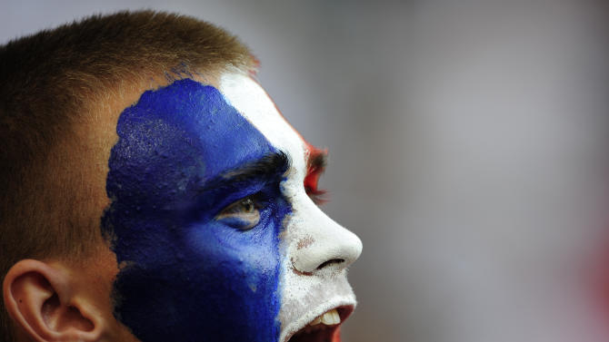A France supporter cheers prior to the Euro 2012 soccer championship Group D match between France and England in Donetsk, Ukraine, Monday, June 11, 2012. (AP Photo/Manu Fernandez)