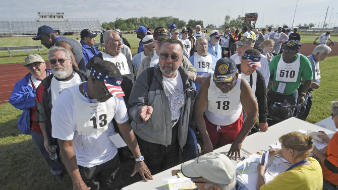 Veterans register for the field events during day one of competition of the National Veterans Golden Age Games hosted by the U.S. Department of Veterans Affairs on Saturday June 1, 2013 in Orchard Park, New York.(Dan Cappellazzo/AP Images for U.S. Department of Veterans Affairs)