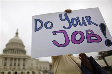 Federal workers demonstrate for an end to the U.S. government shutdown on the west front of the U.S. Capitol in Washington, October 13, 2013. REUTERS/Jonathan Ernst