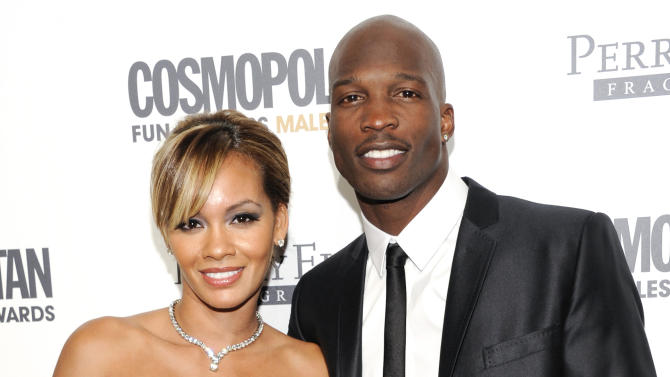 FILE - This March 7, 2011 file photo shows NFL Football player and reality television star Chad Johnson and Evelyn Lozada attending Cosmopolitan Magazine's Fun Fearless Males of 2011 event in New York. Lozada is ending her 41-day-old marriage to Chad Johnson after the football star was arrested for allegedly head-butting her over the weekend.  A rep for the VH1 reality star confirmed reports that Lozada filed for divorce Tuesday, Aug. 14, 2012.  (AP Photo/Evan Agostini, file)