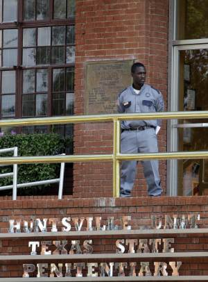 File - In this Sept. 21, 2011 file photo, a corrections officer keeps watch outside the Texas Department of Criminal Justice Huntsville Unit in Huntsville, Texas. On Wednesday, April 2, 2014, a federal judge issued a temporary injunction halting the executions of Tommy Lynn Sells, a convicted serial killer who was set to die Thursday April, 3, 2014, and Ramiro Hernandez-Llanas, another inmate scheduled to die April 9, 2014. U.S. District Judge Vanessa Gilmore declared that the state's prison system must disclose to defense attorneys more information about the supplier of a new batch of lethal-injection drugs. (AP Photo/David J. Phillip, File)