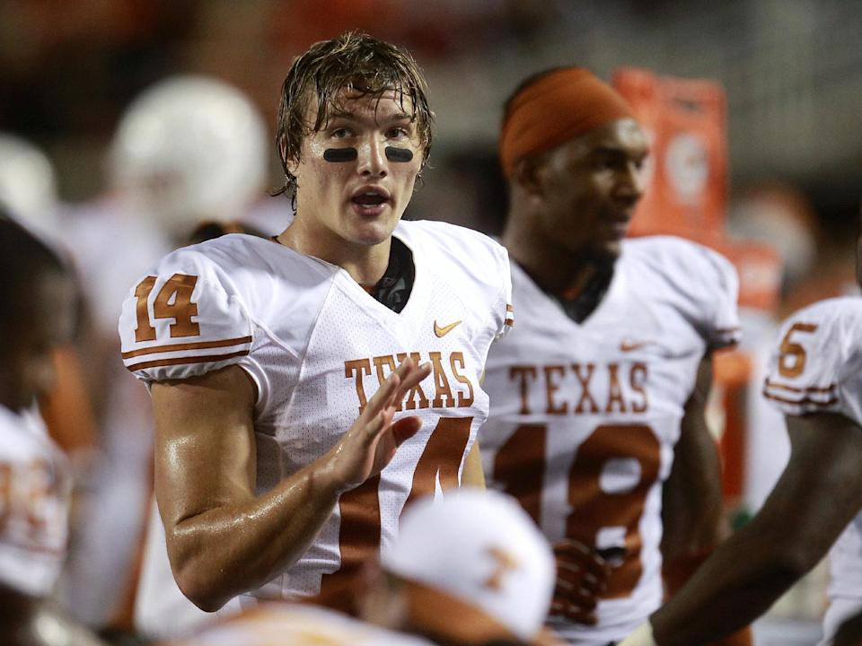 Texas quarterback David Ash (14) talks with his teammates on the bench in the fourth quarter of an NCAA college football game against Oklahoma State in Stillwater, Okla., Saturday, Sept. 29, 2012. Texas won 41-36. (AP Photo/Sue Ogrocki)