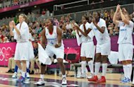 French players cheer their teammates during the Women's preliminary round group B basketball match of the London 2012 Olympic Games France vs Australia at the basketball arena in London. France won 74 to 70