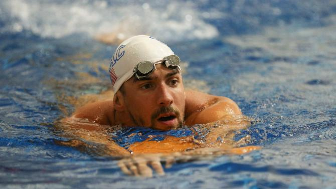 File photo of Michael Phelps warms up prior to finals of the Bulldog Grand Slam at Gabrielsen Natatorium in Athens