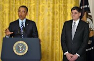 US President Barack Obama announces his choice of Jack Lew (R) as the next Treasury Secretary in the East Room of the White House on January 10, 2013 in Washington, DC.