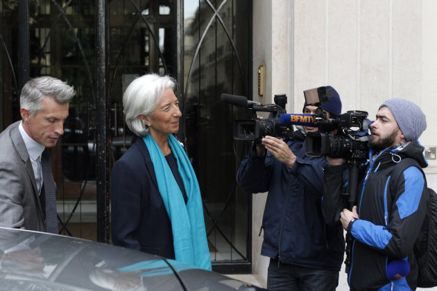 IMF Managing Director Christine Lagarde leaves her apartment building for a French court, in Paris, Thursday, May 23, 2013. Lagarde is being investigated by the special French court over a controversi