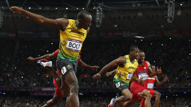 Jamaica's Usain Bolt, foreground left, goes to cross the finish line ahead of Jamaica's Yohan Blake, third from right, United States' Tyson Gay, second from right, and Trinidad's Richard Thompson in the men's 100-meters final during the athletics in the Olympic Stadium at the 2012 Summer Olympics, London, Sunday, Aug. 5, 2012. (AP Photo/Matt Dunham)