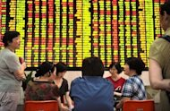 Housewife investors talking at a securities exchange in Shanghai. Asian markets rose and the dollar sank against the euro ahead of a US Federal Reserve meeting most economists expect will deliver fresh stimulus to kickstart the economy