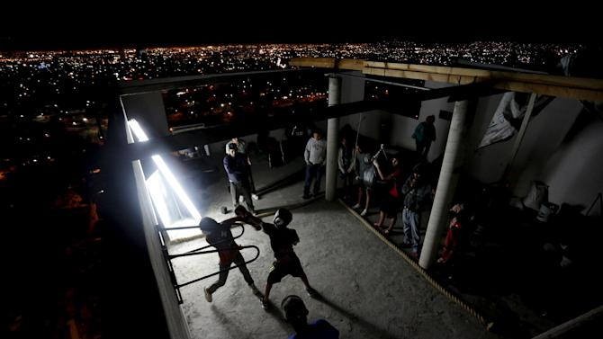 Residents take part in a boxing training session at the rooftop of an apartment as part of the Barrio Esperanza (Hope neighbourhood) project at the rough Cerro de la Campana neighbourhood in Monterrey