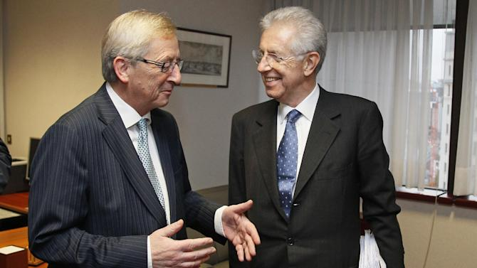 Italian Prime Minister and Finance Minister Mario Monti, right, meets with Luxembourg's Prime Minister Jean-Claude Juncker at the EU Council building in Brussels on Tuesday, Nov. 29, 2011. The 17 finance ministers of countries that use the euro converged on EU headquarters Tuesday in a desperate bid to save their currency and to protect Europe, the United States, Asia and the rest of the global economy from a debt-induced financial tsunami. (AP Photo/Yves Herman, Pool)