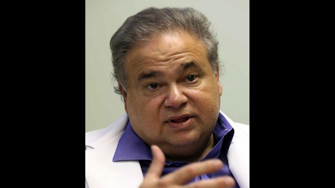 This July 20, 2009 photo shows Dr. Salomon Melgen at his office in West Palm Beach, Fla. Sen. Robert Menendez's office says he reimbursed Melgen, a prominent Florida political donor, $58,500 on Jan. 4 of this year for the full cost of two of three trips Menendez took Melgen's plane to the Dominican Republic in 2010. (AP Photo/The Miami Herald, Hector Gabino)