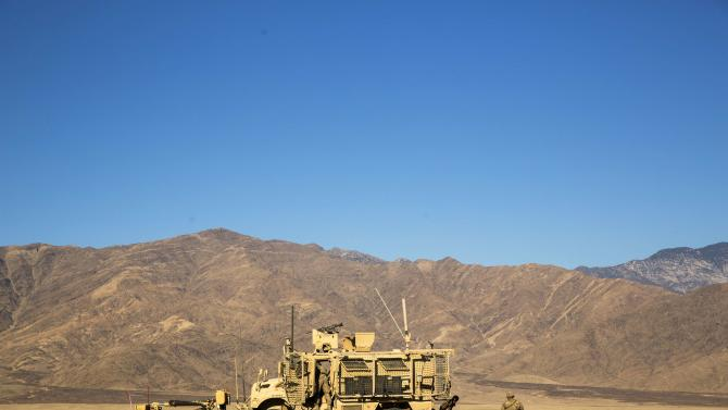 A U.S. soldier from Dragon Company of the 3rd Cavalry Regiment stands outside of an MRAP vehicle near forward operating base Gamberi in the Laghman province of Afghanistan