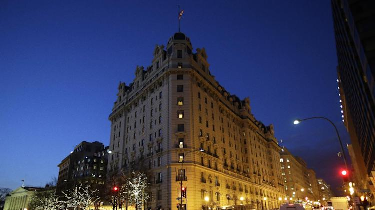FILE - In this Dec. 19, 2012, file photo, the Willard Hotel is seen at dusk in Washington.  At the Willard, about a block from the White House, rooms are still available for the presidential inauguration starting at more than $1,100 a night with a four night minimum. That means every guest will pay more than President Abraham Lincoln did when he checked out after his 1861 inauguration and paid $773.75 for a stay of more than a week. (AP Photo/Jacquelyn Martin)