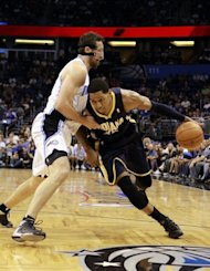 Danny Granger (R) of the Indiana Pacers drives against Hedo Turkoglu of the Orlando Magic in game four of the Eastern Conference quarter-finals during the 2012 NBA Playoffs at Amway Center in Orlando, Florida. The Indiana Pacers squandered a big fourth-quarter lead but held on for a 101-99 over-time win over the Orlando Magic