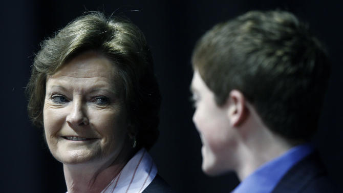 Former Tennessee women's college basketball coach Pat Summitt smiles at her son Tyler Summitt as she appears at a news conference Thursday, April 19, 2012, in Knoxville, Tenn. Summitt, who has more wins than any other college basketball coach, announced Wednesday she is stepping down after 38 seasons due to early-onset dementia. Summitt will become head coach emeritus and former assistant Holly Warlick will become head coach. (AP Photo/Wade Payne)