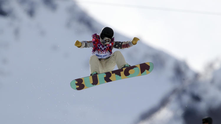United States' Kelly Clark competes in the women's snowboard half pipe qualifying at the Rosa Khutor Extreme Park, at the 2014 Winter Olympics, Wednesday, Feb. 12, 2014, in Krasnaya Polyana, Russia. (AP Photo/Sergei Grits)