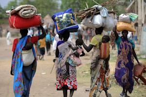 Displaced South Sudanese women walk towards the United …