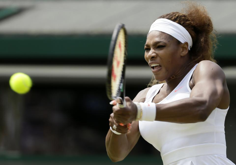 Serena Williams of the United States returns to Caroline Garcia of France during their Women's second round singles match at the All England Lawn Tennis Championships in Wimbledon, London, Thursday, June 27, 2013. (AP Photo/Alastair Grant)
