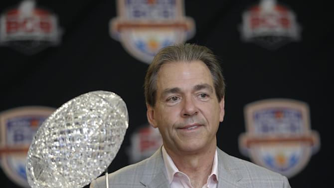 FILE -In a Jan. 8, 2013 file photo Alabama head coach Nick Saban poses with The Coaches' Trophy during a BCS National Championship college football game news conference  in Ft. Lauderdale, Fla. By the time Dylan Moses is old enough to play football at Alabama, Nick Saban would be 65 and starting his 11th season at Tuscaloosa. (AP Photo/Morry Gash)