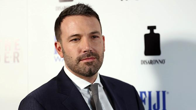 """Actor Ben Affleck arrives at the premiere of """"To The Wonder"""" hosted by FIJI Water on Tuesday, April 9, 2013 in Los Angeles. (Photo by Matt Sayles/Invision for Fiji Water/AP Images)"""