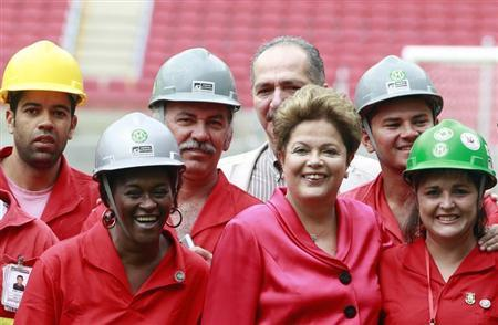 Brazil's President Dilma Rousseff poses with workers during the opening ceremony of the Beira-Rio stadium in Porto Alegre