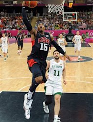 United States' Carmelo Anthony (15) jumps to score past Lithuania's Linas Kleiza during their men's preliminary round basketball game at the 2012 Summer Olympics on Saturday, Aug. 4, 2012, in London. (AP Photo/Mark Ralston, Pool)