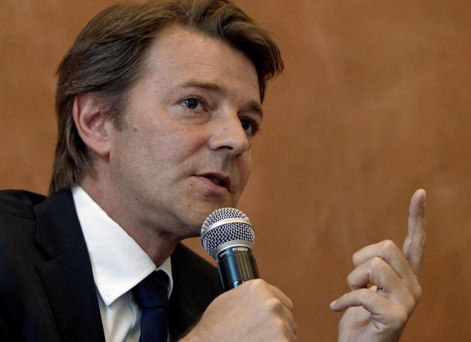 French Economy Minister Francois Baroin gestures as he speaks during a news conference at the French Embassy in Beijing, China, Friday, Aug. 26, 2011.  (AP Photo/Andy Wong)