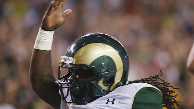 Colorado State running back Dee Hart celebrates after his touchdown run against Colorado in the second quarter of an NCAA college football game in Denver on Friday, Aug. 29, 2014