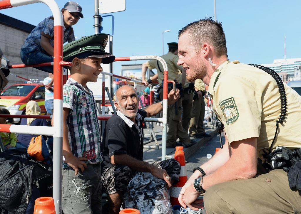 'We love Germany!', cry relieved refugees at Munich station