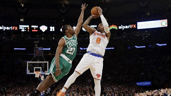 Boston Celtics guard Jordan Crawford (27) defends as New York Knicks guard J.R. Smith (8) shoots a 3-pointer in the first half of Game 2 of their first-round NBA basketball playoff series in New York, Tuesday, April 23, 2013. (AP Photo/Kathy Willens)