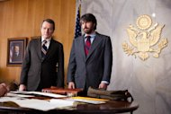 This film image released by Warner Bros. Pictures shows Bryan Cranston, left, as Jack ODonnell and Ben Affleck as Tony Mendez in &quot;Argo,&quot; a rescue thriller about the 1979 Iranian hostage crisis. (AP Photo/Warner Bros., Claire Folger)