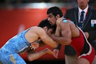India's Sushil Kumar (R) wrestles Japan's Tatsuhiro Yonemitsu in their London Olympics men's 66kg freestyle wrestling final on August 12. Kumar wants to complete his Olympic medal collection by winning gold at the 2016 Games in Rio after taking wrestling silver on the final day of action in London