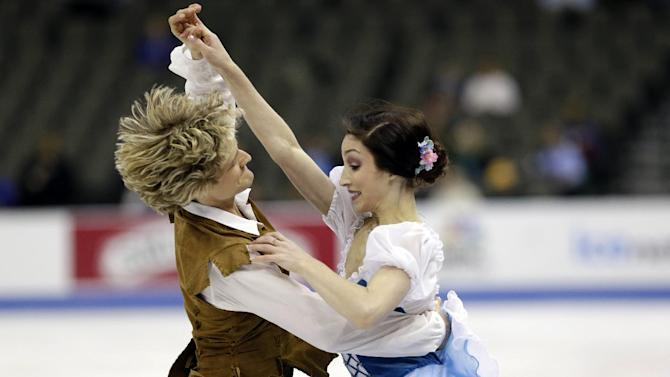 Meryl Davis, right, and Charlie White compete in the senior pairs short dance program at the U.S. figure skating championships in Omaha, Neb., Friday, Jan. 25, 2013. (AP Photo/Nati Harnik)