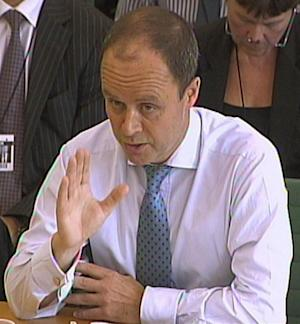 FILE -- London's Metropolitan Police Assistant Commissioner John Yates giving evidence to a House of Commons Home Affairs Committee regarding recent phone hacking allegations, in this July 12, 2011 file photo. Yates resigned Monday July 18, 2011, amid the firestorm surrounding the phone hacking scandal. Yates made a decision two years ago to not re-open police inquiries into phone hacking, saying he did not believe there was any new evidence to consider. He has said in recent weeks that he regrets that decision.(AP Photo/pa, file) UNITED KINGDOM OUT: NO SALES: NO ARCHIVE: