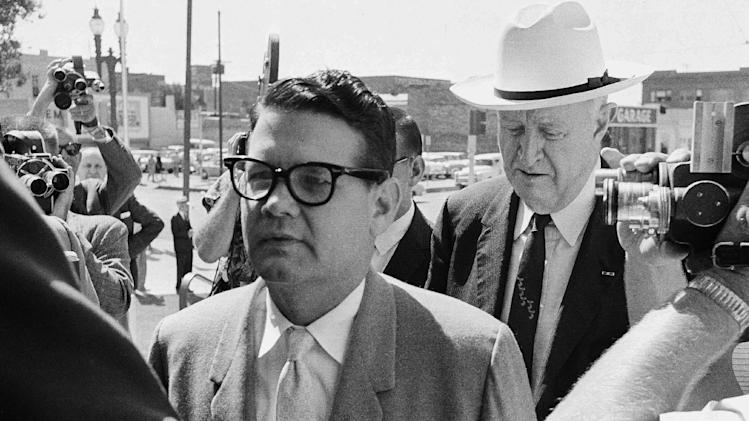 FILE - In this May 23,1962 file photo, Billie Sol Estes, left, and his attorney John Cofer of Austin, Tex. are shown as they arrived at the federal court house in El Paso, Texas. Estes, the flamboyant Texas huckster and con man, has died at age 88. Hood County Sheriff Roger Deed says Estes was found dead in his home in Hood County, Texas, by a caregiver early Tuesday, May 14, 2013.  (AP Photo/Ferd Kaufman, File)