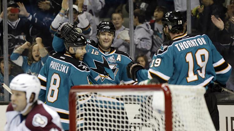 San Jose Sharks center Patrick Marleau (12) celebrates with teammates Joe Pavelski (8) and Joe Thornton (19) after scoring past Colorado Avalanche defenseman Ryan Wilson (44) during the first period of an NHL hockey game in San Jose, Calif., Saturday, Jan. 26, 2013. (AP Photo/Marcio Jose Sanchez)
