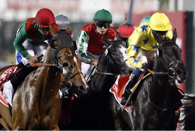 Jockey Joel Rosario (L) rides Animal Kingdom, to win the $10 million Dubai World Cup, the world's richest race, at Meydan race track in Dubai on March 30, 2013. The 2011 Kentucky Derby winner (11/2),