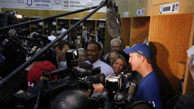 Indianapolis Colts quarterback Peyton Manning talks to reporters in the locker room at the NFL football team's practice facility in Indianapolis, Friday, Dec. 2, 2011. The four-time league MVP gave reporters his latest medical update Friday, saying his workouts will increase and that the next phase of rehabilitation process will include throwing the ball. (AP Photo/Michael Conroy)