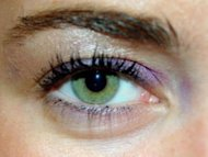 Make hazel eyes look green with purple eyeshadow.