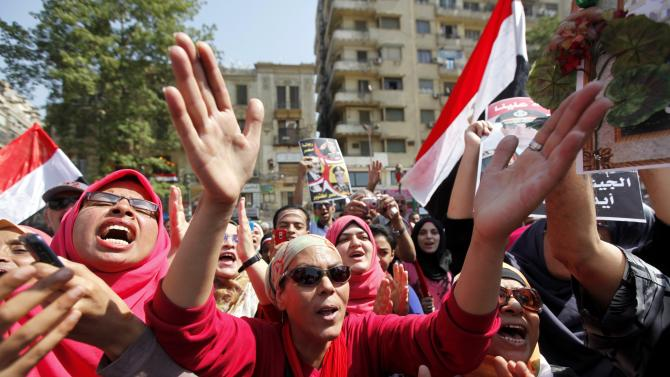 People chant pro-military slogans in Tahrir square as they celebrate the anniversary of an attack on Israeli forces during the 1973 war, in Cairo