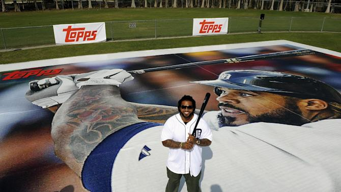 In this image provided by The Topps Company, Detroit Tigers first baseman Prince Fielder poses for a photo after joining nearly 75 Lakeland City Baseball little leaguers to launch the new 2013 Topps Baseball Series 1 cards by unveiling a 90 feet by 60 feet replica of a baseball card with Fielder's image on it, Tuesday, Feb. 12, 2013, in Lakeland, Fla. (AP Photo/The Topps Company, Brian Blanco)