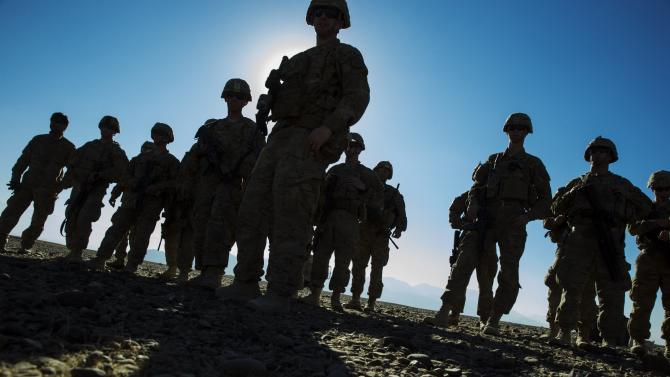 U.S. soldiers from Dragon Company of the 3rd Cavalry Regiment stand outside their vehicles during a mortar exercise near forward operating base Gamberi in the Laghman province of Afghanistan