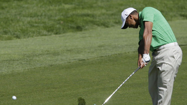 Tiger Woods hits a shot on the fifth hole during the third round of the U.S. Open Championship golf tournament Saturday, June 16, 2012, at The Olympic Club in San Francisco. (AP Photo/Charlie Riedel)