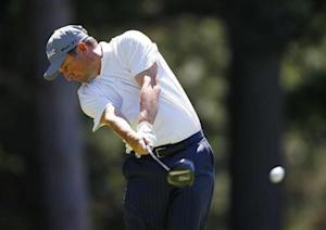 South Africa's Tim Clark hits from the 10th tee during the third round of the 2013 PGA Championship golf tournament at Oak Hill Country Club in Rochester