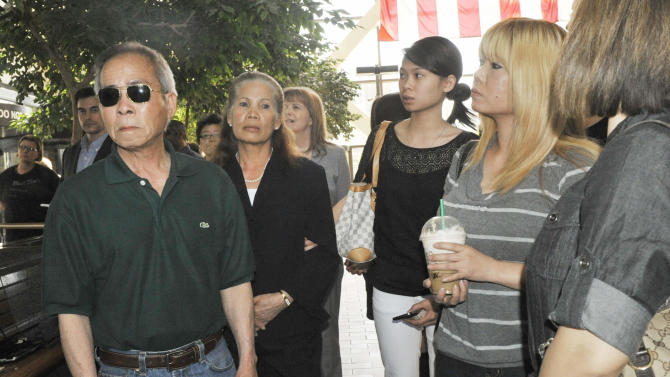 Family members of Anousone Phanthavong wait to address the media after a jury found Amy Senser, the wife of former Minnesota Vikings NFL football star Joe Senser, guilty Thursday, May 3, 2012, in Minneapolis , on two felonies in a hit-and-run that killed Phanthavong last year. (AP Photo/Jim Mone)