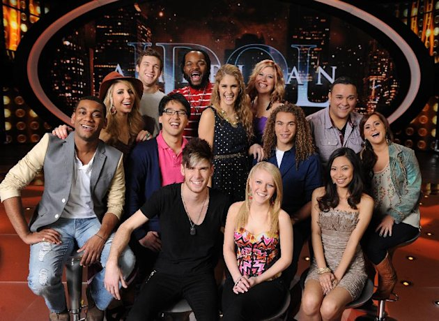 "In this March 1, 2012 image released by Fox, the remaining 13 contestants from the singing competition series, ""American Idol,"" are shown in Los Angeles. (AP Photo/Fox, Michael Becker)"