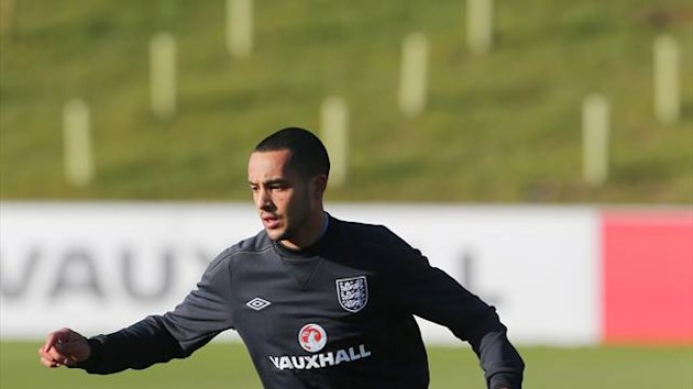 Theo Walcott believes he can play up front just as he has done with Arsenal